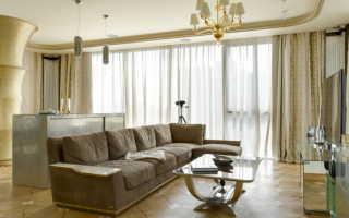 Коричневый угловой диван в интерьере